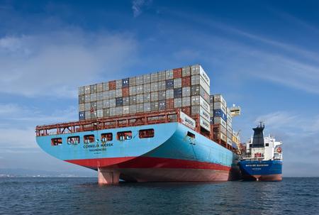 Nakhodka Bay. East (Japan) Sea. 17 September 2015: Bunkering tanker Vitaly Vanykhin container ship Cornelia Maersk.