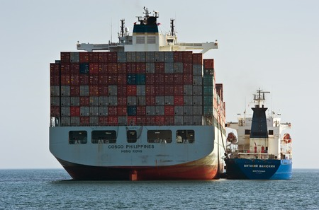 vitaly: Nakhodka. Russia - August 01, 2014: Bunkering tanker Vitaly Vanyhin a container ship COSCO Phillipines.