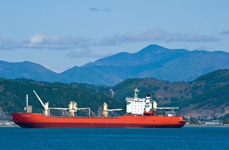 alumina: Nakhodka. Russia - October 04, 2015: Bulk carrier Yuri Arsenievsky at anchored in the roads. Editorial