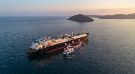 Nakhodka, Russia - June 22, 2017: Tanker Zaliv Nakhodka is engaged in bunkering LNG-tanker Ob River is anchored in the road.