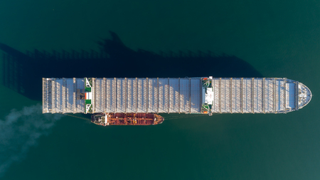 Top view of a large empty container ship and a tanker.