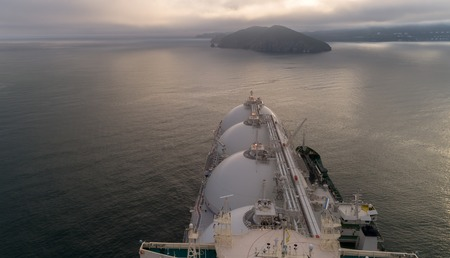 Top view of a large LNG tanker and a tanker standing side by side. Banco de Imagens - 83655187