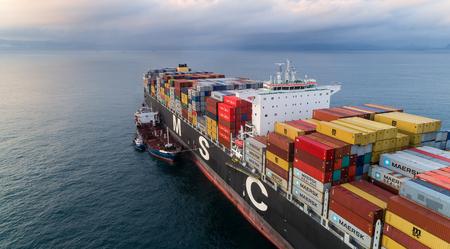russkiy: Nakhodka. Russia - September 05, 2017: Bunkering tanker Ostrov Russkiy a large container ship MSC Beryl. Editorial