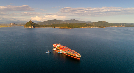 russkiy: Nakhodka. Russia - September 02, 2017: Bunkering tanker Ostrov Russkiy a large container ship NYK Aquarius.