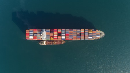 Top view of a large loaded container ship and a tanker.