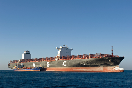 Nakhodka, Russia - February 01, 2018: Tanker Zaliv Petra Velikogo bunker container ship Tayma standing in the roadstead of the winter sea.