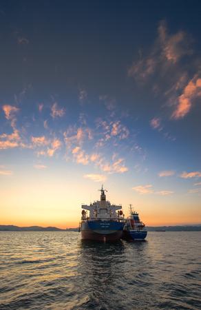 Nakhodka. Russia - September 21, 2017: Kodiak Island anchored in the roadstead Tanker Zaliv Vostok bunkering bulk carrier.