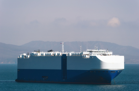 Ro-ro ship standing on the roads at anchor. 免版税图像