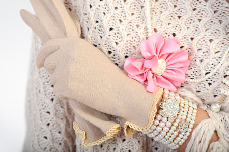 Elegant woman hand and beige gloves photo