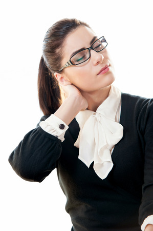Businesswoman with black dress showing a neck pain photo