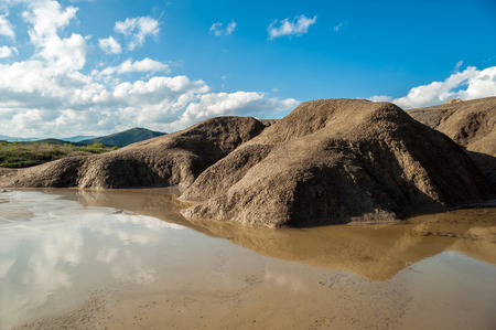Rain water lake on mud volcano 스톡 콘텐츠