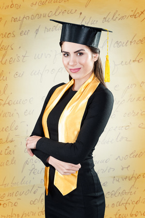 graduating: Portrait of graduating student dressed in robe and with graduation gown Stock Photo