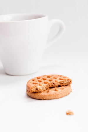 breakfast food: Breakfast food: ceramic white cup with chocolate and butter cookies isolated over white background