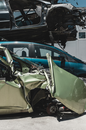 pile engine: Crashed car in dismantling yard.