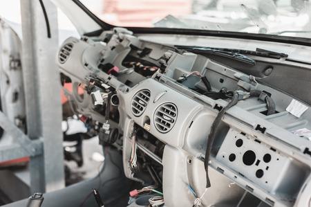 pile reuse engine: Crashed car in dismantling yard.