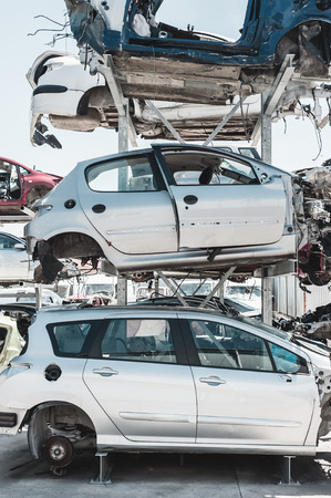pile reuse engine: Crashed cars in dismantling yard.