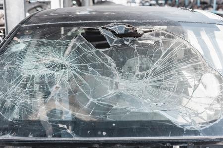 pile reuse engine: Crashed car window in dismantling yard.