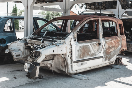 eyesore: Rusted torched car