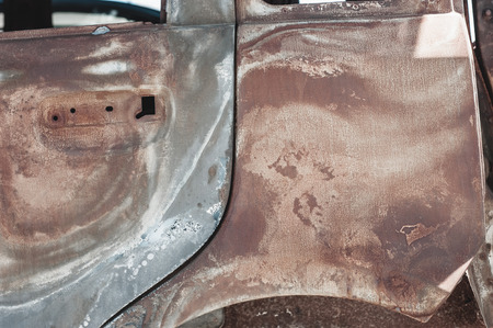 eyesore: Rusted torched car detail.