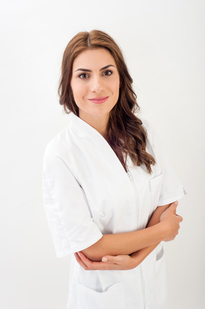general practice: Smiling medical nurse in medical doctor uniform  isolated over white background.