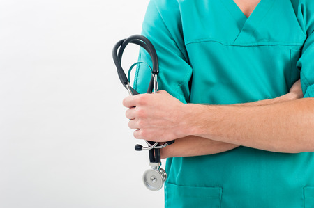 medical doctors: Male nurse with a stethoscope in the hands Stock Photo