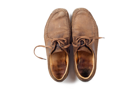 men s feet: Man leather brown shoes on white background Stock Photo