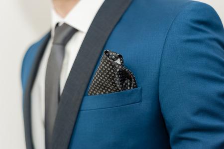 フォーマルな服装に身を包んだ男のクローズ アップ ショット。新郎のスーツ 写真素材