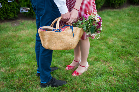 without legs: Couple in the grass, only legs, engagement photo, before wedding, picnic, sunny day, romantic photo, without face, girl with pin up dress, vintage color