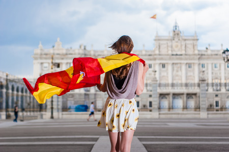 palacio: Young woman in front of Palacio de Oriente  Stock Photo