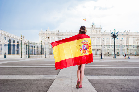 Young woman in front of Palacio de Oriente Stockfoto