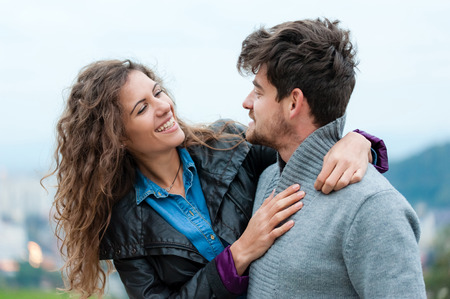 Pretty couple hugging, flirting and laughing. Reklamní fotografie