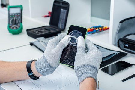 Close-up photos showing process of mobile phone repair