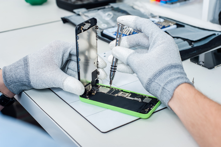 landline: Close-up photos showing process of mobile phone repair