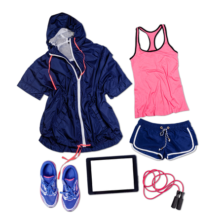 Sports outfit and equipment on wooden floor.
