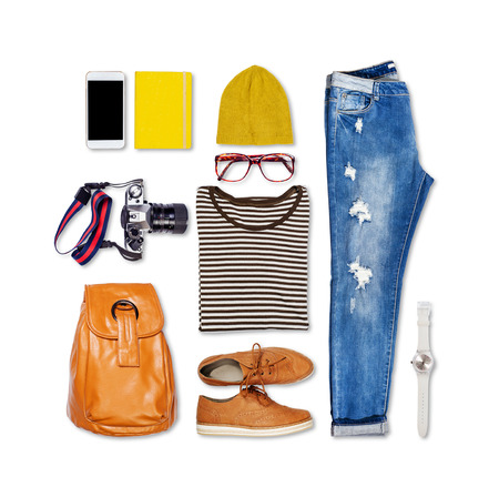 Overhead of hipster woman essentials. Outfit of casual woman on isolated background. Standard-Bild