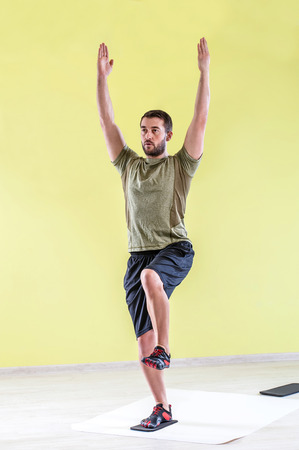 friction: Man at gym, exercising with friction pads.