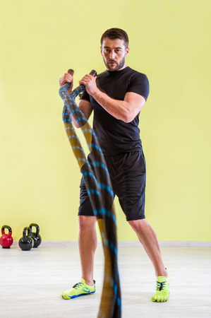 battling: Fitness battling ropes at gym workout fitness exercise