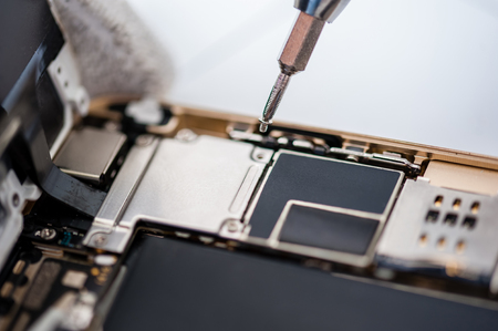Close-up photos showing process of mobile phone repair.