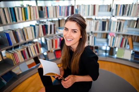 Young student girl in a library