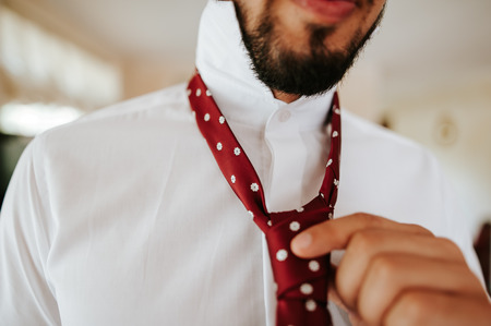 Close-up of a businessman putting a tie. Stock Photo