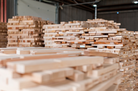 Stack of wood in warehouse in a furniture manufacture production. Stock Photo