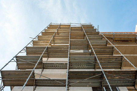 reinforcement: Building block of flats under construction with scaffolding. Stock Photo