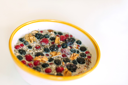 Close-up picture of bowl with cereal porridge and fruits. 写真素材