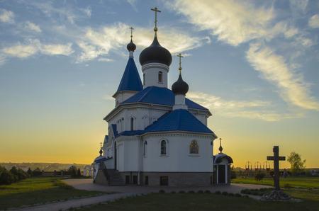 the orthodox church: Belarus, Minsk: orthodox church of Saint Nicholas The Wonderworker beams of the setting sun. Stock Photo