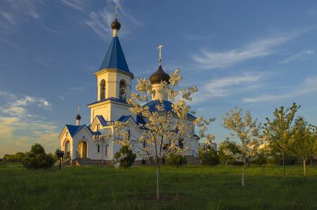orthodox church: Belarus, Minsk: orthodox church of Saint Nicholas The Wonderworker beams of the setting sun. Stock Photo
