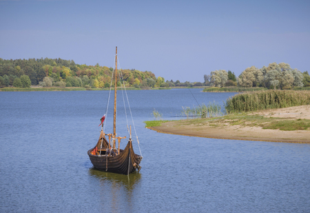 middle ages boat: Belarus, Nesvizh: an ancient castle on a water smooth surface. Stock Photo