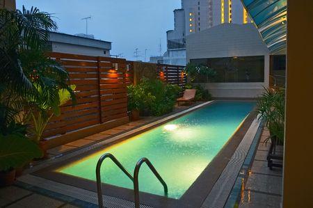 enclosures: Swimming pool and evening rain Stock Photo