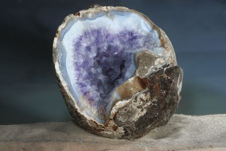 Amethyst geode in the blue agate shooted under water