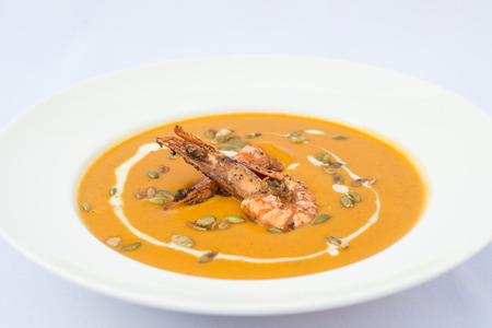 pumpkin cream soup with prawns Stock Photo