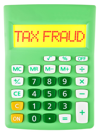 Calculator with TAX FRAUD on display on white background photo